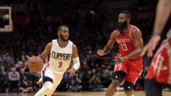 Jan 18, 2016; Los Angeles, CA, USA; Los Angeles Clippers guard Chris Paul (3) is defended by Houston Rockets guard James Harden (13) during an NBA basketball game at Staples Center. The Clippers defeated the Rockers 140-132 in overtime. Mandatory Credit: Kirby Lee-USA TODAY Sports
