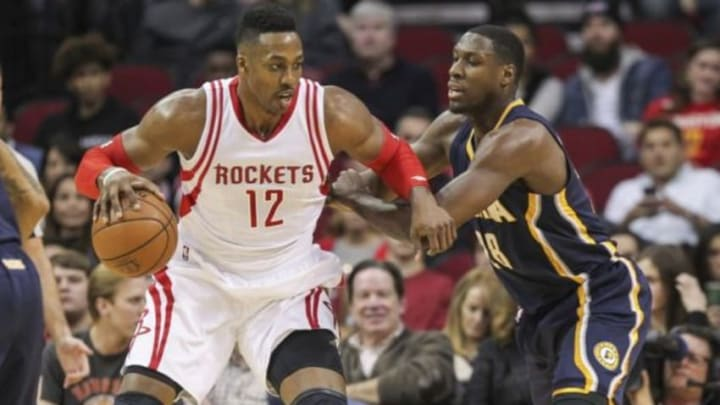 Jan 10, 2016; Houston, TX, USA; Houston Rockets center Dwight Howard (12) drives towards the basket as Indiana Pacers center Ian Mahinmi (28) defends during the first quarter at Toyota Center. Mandatory Credit: Troy Taormina-USA TODAY Sports