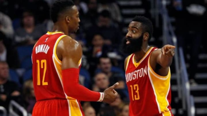 Jan 14, 2015; Orlando, FL, USA; Houston Rockets center Dwight Howard (12) and guard James Harden (13) talk against the Orlando Magic during the second quarter at Amway Center. Mandatory Credit: Kim Klement-USA TODAY Sports