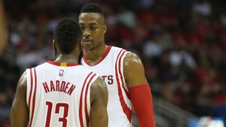 Jan 19, 2015; Houston, TX, USA; Houston Rockets guard James Harden (13) talks with center Dwight Howard (12) during a Indiana Pacers timeout in the second half at Toyota Center. Rockets won 110 to 98. Mandatory Credit: Thomas B. Shea-USA TODAY Sports
