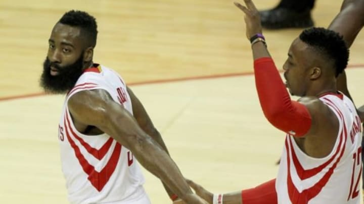 Jan 19, 2015; Houston, TX, USA; Houston Rockets center Dwight Howard (12) high fives Rockets guard James Harden (13) during the game against the Indiana Pacers in the first half at Toyota Center. Mandatory Credit: Thomas B. Shea-USA TODAY Sports