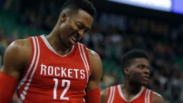 Jan 4, 2016; Salt Lake City, UT, USA; Houston Rockets center Dwight Howard (12) reacts after being hit in the eye in the first quarter against the Utah Jazz at Vivint Smart Home Arena. Mandatory Credit: Jeff Swinger-USA TODAY Sports