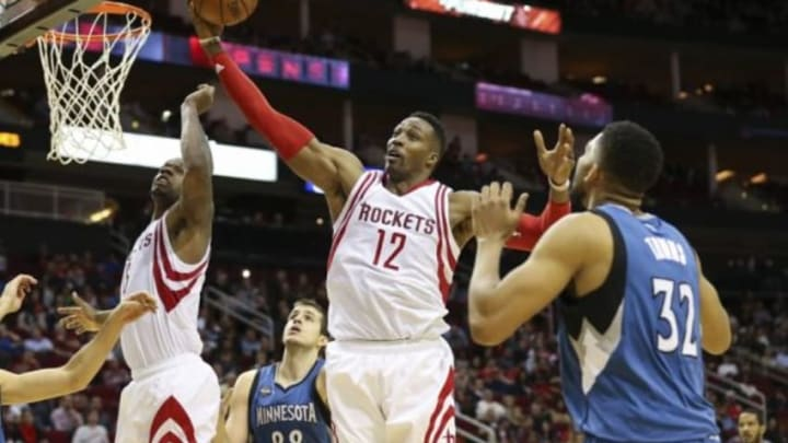 Jan 13, 2016; Houston, TX, USA; Houston Rockets center Dwight Howard (12) attempts to get a rebound during the fourth quarter against the Minnesota Timberwolves at Toyota Center. The Rockets won 107-104. Mandatory Credit: Troy Taormina-USA TODAY Sports