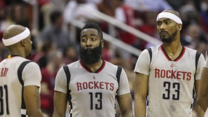Jan 15, 2016; Houston, TX, USA; Houston Rockets guard James Harden (13) talks with teammates during the fourth quarter against the Cleveland Cavaliers at Toyota Center. Mandatory Credit: Troy Taormina-USA TODAY Sports
