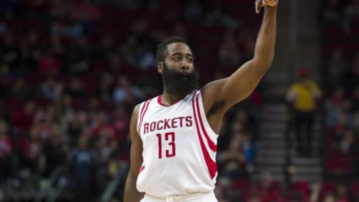 Jan 22, 2016; Houston, TX, USA; Houston Rockets guard James Harden (13) celebrates making a three point shot against the Milwaukee Bucks during the first quarter at the Toyota Center. Mandatory Credit: Jerome Miron-USA TODAY Sports