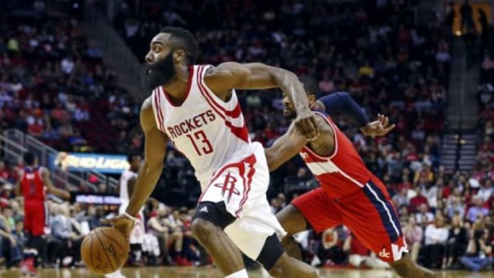 Jan 30, 2016; Houston, TX, USA; Houston Rockets guard James Harden (13) dribbles the ball after a steal during the second quarter against the Washington Wizards at Toyota Center. Mandatory Credit: Troy Taormina-USA TODAY Sports