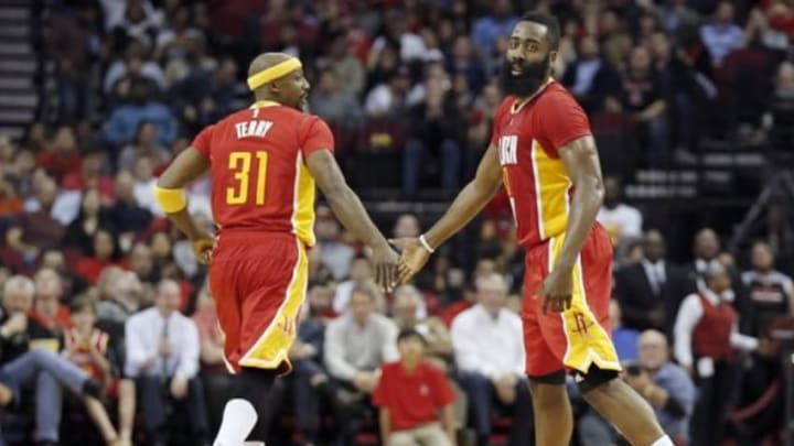 Jan 7, 2016; Houston, TX, USA; Houston Rockets guard Jason Terry (31) and guard James Harden (13) low five each other while playing against the Utah Jazz in the second half at Toyota Center. Rockets won 103 to 94. Mandatory Credit: Thomas B. Shea-USA TODAY Sports