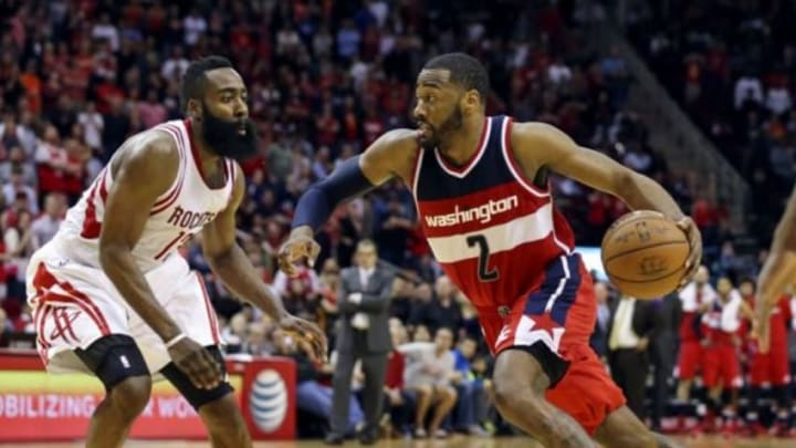 Jan 30, 2016; Houston, TX, USA; Washington Wizards guard John Wall (2) drives the ball to the basket as Houston Rockets guard James Harden (13) defends during the fourth quarter at Toyota Center. The Wizards won 123-122. Mandatory Credit: Troy Taormina-USA TODAY Sports