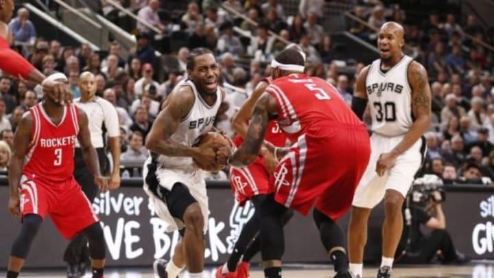 Jan 27, 2016; San Antonio, TX, USA; San Antonio Spurs small forward Kawhi Leonard (2) is fouled by Houston Rockets center Josh Smith (5) during the first half at AT&T Center. Mandatory Credit: Soobum Im-USA TODAY Sports