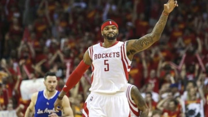 May 17, 2015; Houston, TX, USA; Houston Rockets forward Josh Smith (5) reacts after making a basket during the third quarter against the Los Angeles Clippers in game seven of the second round of the NBA Playoffs at Toyota Center. Mandatory Credit: Troy Taormina-USA TODAY Sports