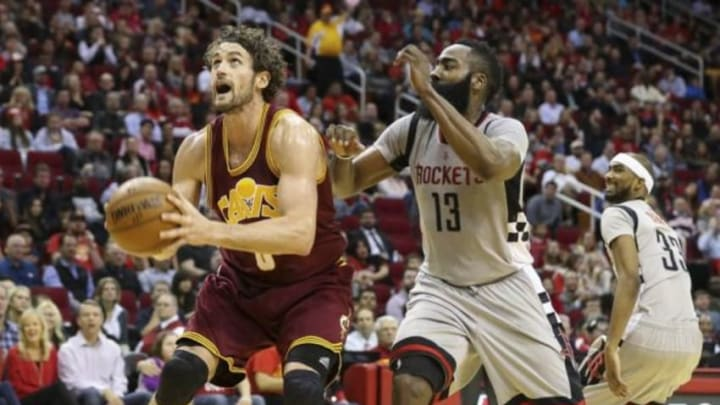 Jan 15, 2016; Houston, TX, USA; Cleveland Cavaliers forward Kevin Love (0) scores a basket as Houston Rockets guard James Harden (13) defends during the third quarter at Toyota Center. The Cavaliers won 91-77. Mandatory Credit: Troy Taormina-USA TODAY Sports