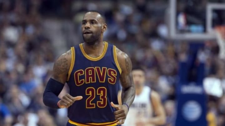 Jan 12, 2016; Dallas, TX, USA; Cleveland Cavaliers forward LeBron James (23) runs back up court after making a three point shot against the Dallas Mavericks during the first half at the American Airlines Center. Mandatory Credit: Jerome Miron-USA TODAY Sports