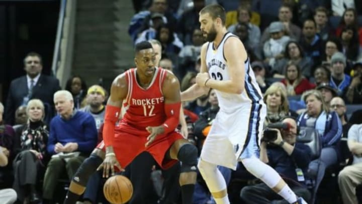 Jan 12, 2016; Memphis, TN, USA; Houston Rockets center Dwight Howard (12) dribbles as Memphis Grizzlies center Marc Gasol (33) defends in the first quarter at FedExForum. Mandatory Credit: Nelson Chenault-USA TODAY Sports