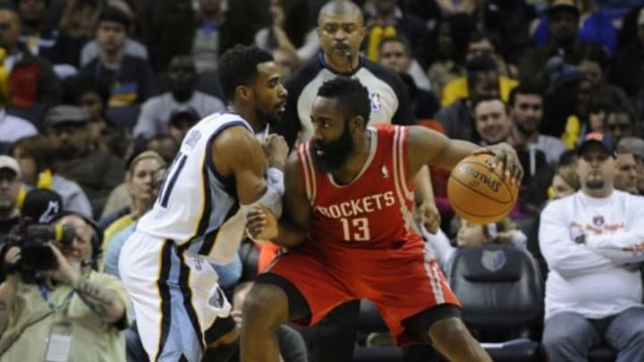 Jan 25, 2014; Memphis, TN, USA; Memphis Grizzlies point guard Mike Conley (11) guards Houston Rockets shooting guard James Harden (13) during the second quarter at FedExForum. Mandatory Credit: Justin Ford-USA TODAY Sports