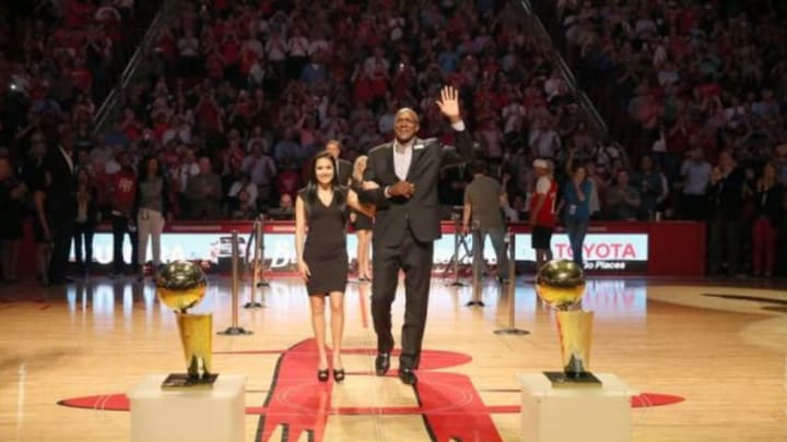 Mar 19, 2015; Houston, TX, USA; Former Houston Rockets Clyde Drexler waves to the crowd as he is introduced during halftime of the Houston Rockets and Denver Nuggets game at Toyota Center in honor of the 20th anniversary the Rockets were honoring their 1993-94 and 1994-95 Champion NBA teams. Rockets won 118 to 108. Mandatory Credit: Thomas B. Shea-USA TODAY Sports