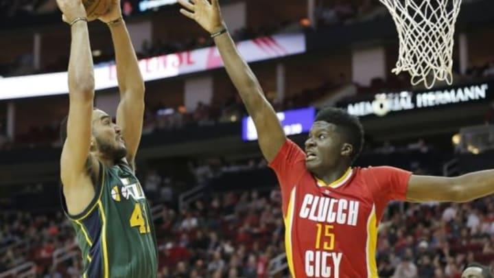 Jan 7, 2016; Houston, TX, USA; Utah Jazz forward Trey Lyles (41) dunks against Houston Rockets forward Clint Capela (15) in the second quarter at Toyota Center. Mandatory Credit: Thomas B. Shea-USA TODAY Sports