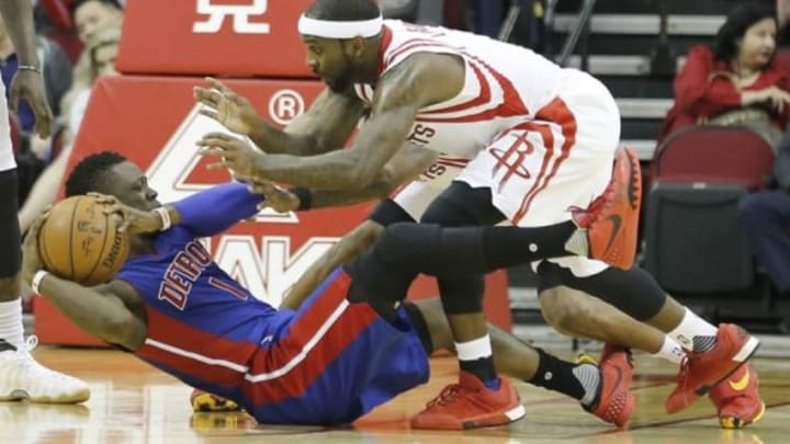 Jan 20, 2016; Houston, TX, USA; Detroit Pistons guard Reggie Jackson (1) is defended by Houston Rockets guard Ty Lawson (3) in the second quarter at Toyota Center. Mandatory Credit: Thomas B. Shea-USA TODAY Sports
