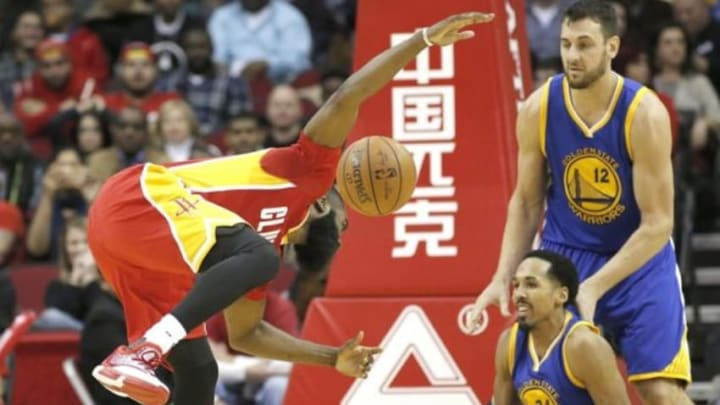 Dec 31, 2015; Houston, TX, USA; Houston Rockets guard James Harden (13) is called for charging against the Golden State Warriors guard Shaun Livingston (34) in the second half at Toyota Center. The Warriors won 114 to 110. Mandatory Credit: Thomas B. Shea-USA TODAY Sports