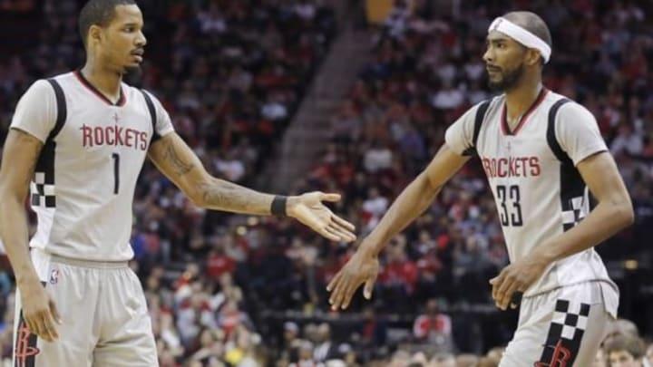 Jan 24, 2016; Houston, TX, USA; Houston Rockets forward Trevor Ariza (1) and guard Corey Brewer (33) reacts agains the Dallas Mavericks in the second half at Toyota Center. Rockets won 115 to 104. Mandatory Credit: Thomas B. Shea-USA TODAY Sports