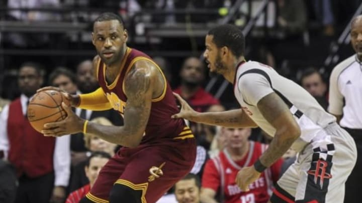 Jan 15, 2016; Houston, TX, USA; Cleveland Cavaliers forward LeBron James (23) controls the ball during the first quarter as Houston Rockets forward Trevor Ariza (1) defends at Toyota Center. Mandatory Credit: Troy Taormina-USA TODAY Sports