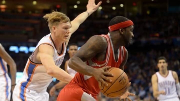 Jan 29, 2016; Oklahoma City, OK, USA; Houston Rockets guard Ty Lawson (3) drives to the basket in front of Oklahoma City Thunder forward Kyle Singler (5) during the second quarter at Chesapeake Energy Arena. Mandatory Credit: Mark D. Smith-USA TODAY Sports