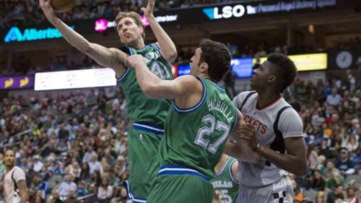 Dec 4, 2015; Dallas, TX, USA; Dallas Mavericks forward Dirk Nowitzki (41) grabs a rebound in front of center Zaza Pachulia (27) and Houston Rockets center Clint Capela (15) during the second half at the American Airlines Center. The Rockets defeat the Mavericks 100-96. Mandatory Credit: Jerome Miron-USA TODAY Sports