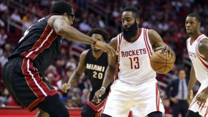 Feb 2, 2016; Houston, TX, USA; Houston Rockets guard James Harden (13) dribbles the ball as Miami Heat forward Amar
