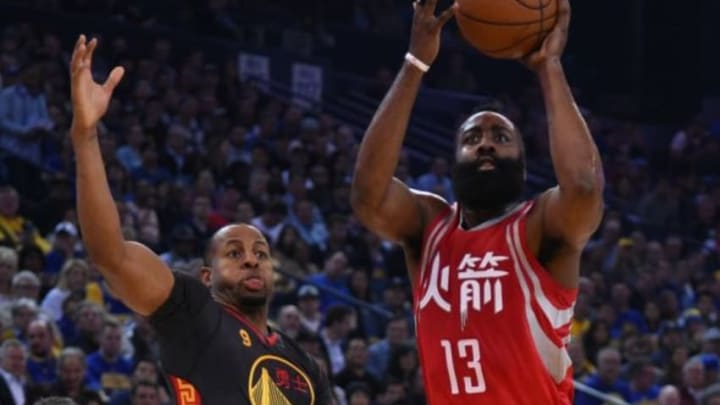 February 9, 2016; Oakland, CA, USA; Houston Rockets guard James Harden (13) shoots the basketball against Golden State Warriors forward Andre Iguodala (9) during the first quarter at Oracle Arena. Mandatory Credit: Kyle Terada-USA TODAY Sports