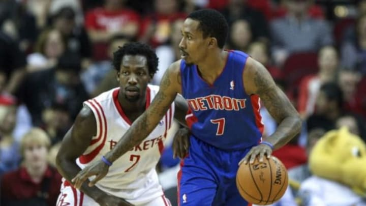 Mar 1, 2014; Houston, TX, USA; Detroit Pistons point guard Brandon Jennings (7) controls the ball during the first quarter as Houston Rockets point guard Patrick Beverley (2) defends at Toyota Center. Mandatory Credit: Troy Taormina-USA TODAY Sports