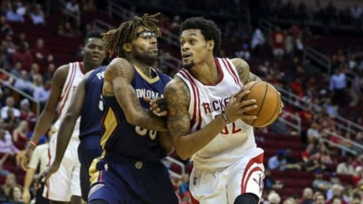 Oct 19, 2015; Houston, TX, USA; Houston Rockets guard K.J. McDaniels (32) drives to the basket during the second quarter as New Orleans Pelicans guard Chris Douglas-Roberts (55) defends at Toyota Center. Mandatory Credit: Troy Taormina-USA TODAY Sports