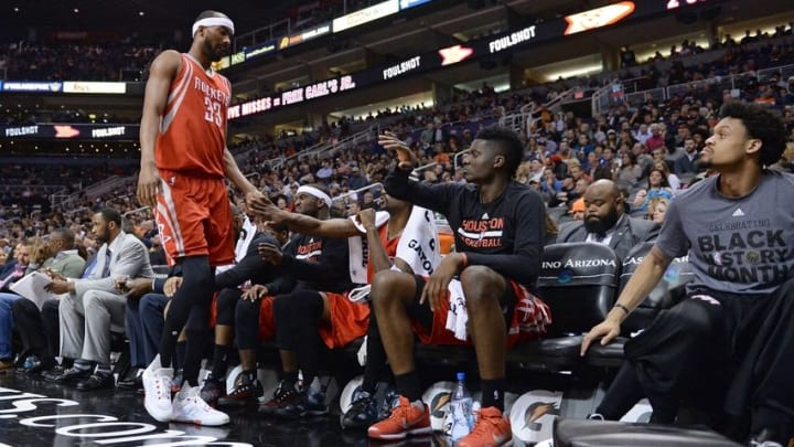 Feb 4, 2016; Phoenix, AZ, USA; Houston Rockets guard Corey Brewer (33) is congratulated by teammates on the bench during the game against the Phoenix Suns at Talking Stick Resort Arena. Mandatory Credit: Jennifer Stewart-USA TODAY Sports