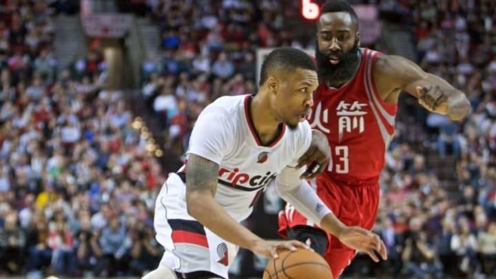 Feb 10, 2016; Portland, OR, USA; Portland Trail Blazers guard Damian Lillard (0) drives past Houston Rockets guard James Harden (13) during the fourth quarter at the Moda Center. Mandatory Credit: Craig Mitchelldyer-USA TODAY Sports