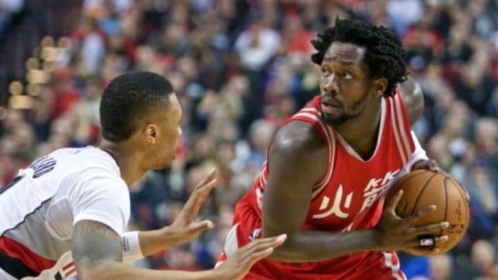 Feb 10, 2016; Portland, OR, USA; Houston Rockets guard Patrick Beverley (2) looks to pass around Portland Trail Blazers guard Damian Lillard (0) during the second quarter at the Moda Center. Mandatory Credit: Craig Mitchelldyer-USA TODAY Sports