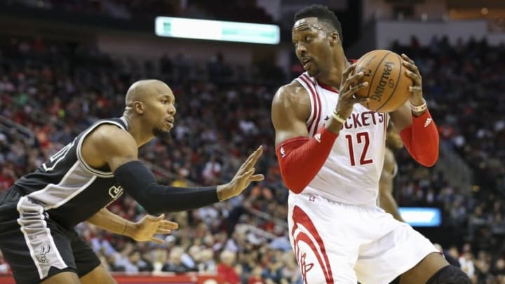 Feb 27, 2016; Houston, TX, USA; Houston Rockets center Dwight Howard (12) controls the ball as San Antonio Spurs center Boris Diaw (33) defends during the third quarter at Toyota Center. The Spurs defeated the Rockets 104-94. Mandatory Credit: Troy Taormina-USA TODAY Sports