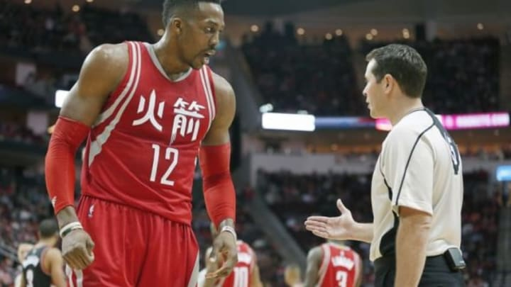 Feb 6, 2016; Houston, TX, USA; Houston Rockets center Dwight Howard (12) argues a call with official Brian Forte (45) while playing against the Portland Trail Blazers in the second quarter at Toyota Center. Mandatory Credit: Thomas B. Shea-USA TODAY Sports