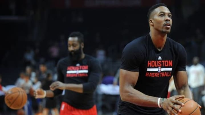 November 7, 2015; Los Angeles, CA, USA; Houston Rockets center Dwight Howard (12) and guard James Harden (13) during the shoot around before playing against Los Angeles Clippers at Staples Center. Mandatory Credit: Gary A. Vasquez-USA TODAY Sports