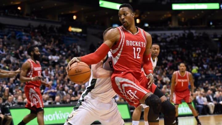 Feb 29, 2016; Milwaukee, WI, USA; Houston Rockets center Dwight Howard (12) spins around Milwaukee Bucks center Miles Plumlee (18) in the first quarter at BMO Harris Bradley Center. Mandatory Credit: Benny Sieu-USA TODAY Sports