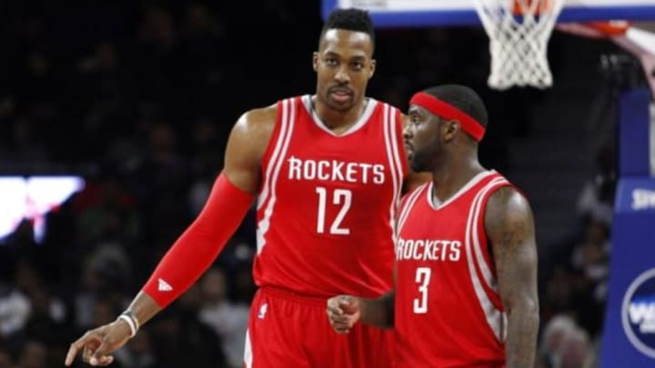 Nov 30, 2015; Auburn Hills, MI, USA; Houston Rockets center Dwight Howard (12) and guard Ty Lawson (3) talk during the fourth quarter against the Detroit Pistons at The Palace of Auburn Hills. Pistons win 116-105. Mandatory Credit: Raj Mehta-USA TODAY Sports