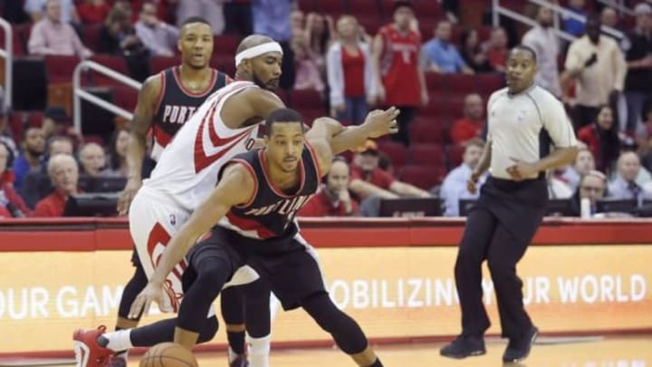 Nov 18, 2015; Houston, TX, USA; Portland Trail Blazers forward Allen Crabbe (23) dribbles against Houston Rockets guard Jason Terry (31) in the second half at Toyota Center. The Rockets won in overtime 108-103. Mandatory Credit: Thomas B. Shea-USA TODAY Sports