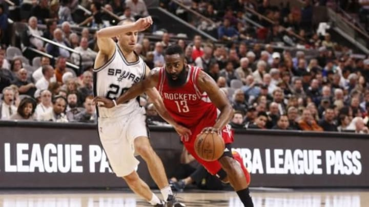 Jan 27, 2016; San Antonio, TX, USA; Houston Rockets shooting guard James Harden (13) drives to the basket while guarded by San Antonio Spurs shooting guard Manu Ginobili (20) during the second half at AT&T Center. Mandatory Credit: Soobum Im-USA TODAY Sports