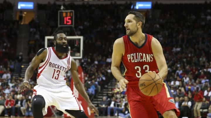 Dec 2, 2015; Houston, TX, USA; New Orleans Pelicans forward Ryan Anderson (33) dribbles the ball as Houston Rockets guard James Harden (13) defends during the fourth quarter at Toyota Center. The Rockets defeated the Pelicans 108-101. Mandatory Credit: Troy Taormina-USA TODAY Sports