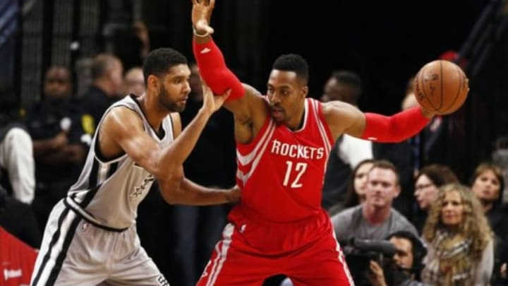 Jan 2, 2016; San Antonio, TX, USA; Houston Rockets center Dwight Howard (12) is defended by San Antonio Spurs power forward Tim Duncan (L) during the first half at AT&T Center. Mandatory Credit: Soobum Im-USA TODAY Sports