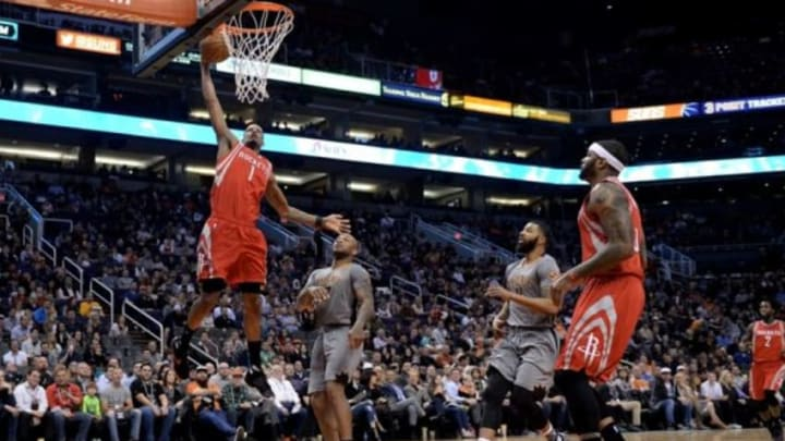 Feb 4, 2016; Phoenix, AZ, USA; Houston Rockets forward Trevor Ariza (1) dunks the ball against Phoenix Suns forward P.J. Tucker (17) at Talking Stick Resort Arena. Mandatory Credit: Jennifer Stewart-USA TODAY Sports