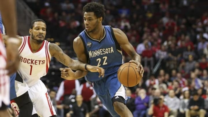 Jan 13, 2016; Houston, TX, USA; Minnesota Timberwolves guard Andrew Wiggins (22) drives the ball during the fourth quarter as Houston Rockets forward Trevor Ariza (1) defends at Toyota Center. The Rockets won 107-104. Mandatory Credit: Troy Taormina-USA TODAY Sports