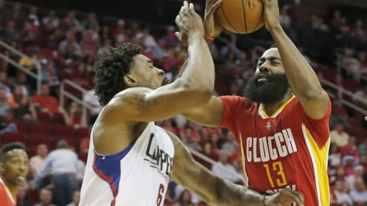 Mar 16, 2016; Houston, TX, USA; Houston Rockets guard James Harden (13) drives against Los Angeles Clippers center DeAndre Jordan (6) in the first quarter at Toyota Center. Mandatory Credit: Thomas B. Shea-USA TODAY Sports