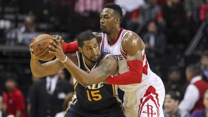 Mar 23, 2016; Houston, TX, USA; Utah Jazz forward Derrick Favors (15) controls the ball as Houston Rockets center Dwight Howard (12) defends during the second half at Toyota Center. The Jazz won 89-87. Mandatory Credit: Troy Taormina-USA TODAY Sports
