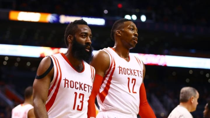 Jan 23, 2015; Phoenix, AZ, USA; Houston Rockets guard James Harden (13) and center Dwight Howard (12) in the first quarter against the Phoenix Suns at US Airways Center. Mandatory Credit: Mark J. Rebilas-USA TODAY Sports