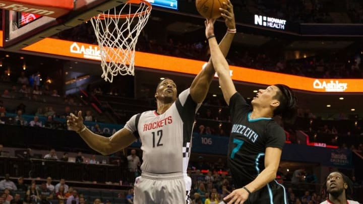 Mar 12, 2016; Charlotte, NC, USA; Houston Rockets center Dwight Howard (12) knocks the ball away from Charlotte Hornets guard Jeremy Lin (7) in the first half at Time Warner Cable Arena. Mandatory Credit: Jeremy Brevard-USA TODAY Sports