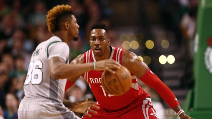 Mar 11, 2016; Boston, MA, USA; Boston Celtics guard Marcus Smart (36) dribbles as Houston Rockets center Dwight Howard (right) defends during the first half at TD Garden. Mandatory Credit: Mark L. Baer-USA TODAY Sports
