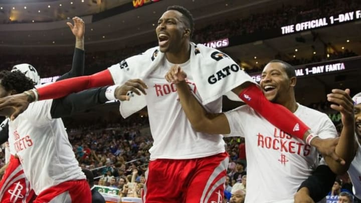 Mar 9, 2016; Philadelphia, PA, USA; Houston Rockets center Dwight Howard (12) and teammates celebrate from the bench after the Rockets